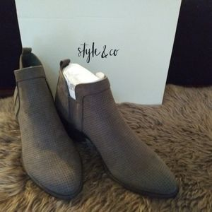 Brand new Grey booties never worn. Size 6.5